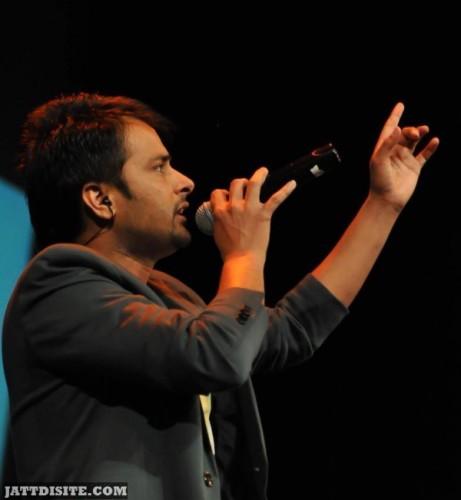 Amrinder gill Holding A Mike