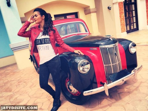 Surveen Chawla Posing With Car'