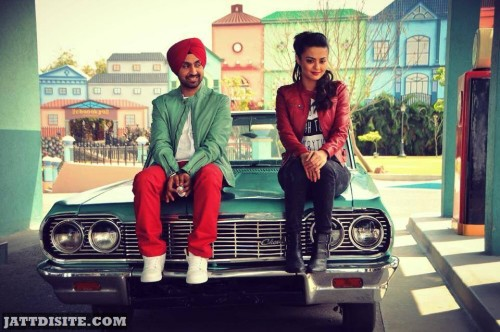 Surveen Chawla Sitting On Car