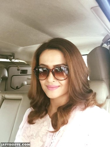 Surveen Chawla Smiling Photo In Car