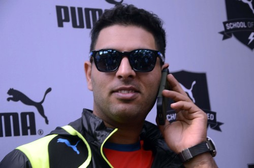 Indian cricketer Yuvraj Singh during launch of a sports shoe in Mumbai on Jan.15, 2014. (Photo: Sandeep Mahankal/IANS)