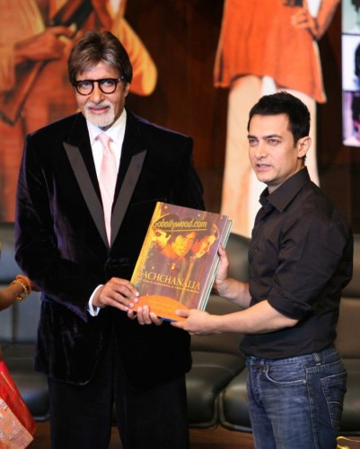 Big B Presenting a Book to Aamir