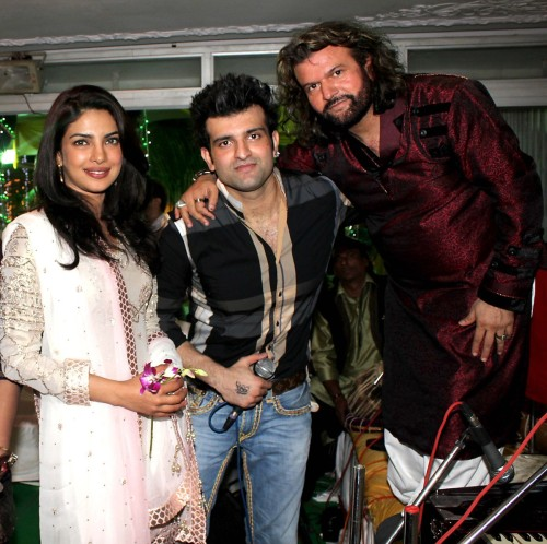 Priyanka Chopra posing with singer Hans Raj Hans and his son at 89th birthday party of Dilip Kumar in Mumbai