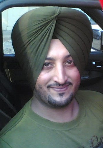 Inderjit Nikku Posing From His Car